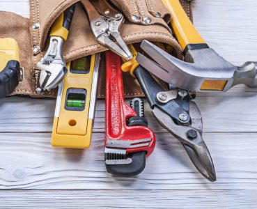 Tool belt pliers construction level tape line claw hammer pipe wrench adjustable spanner.